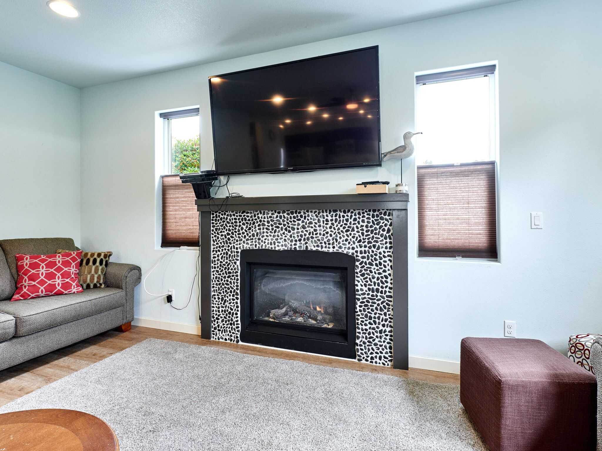 Vacation home living room fireplace.