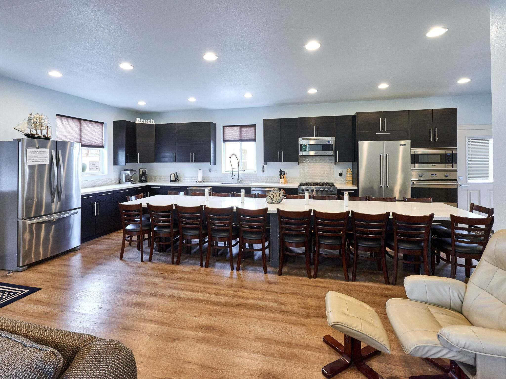 Vacation home kitchen and long dining table.