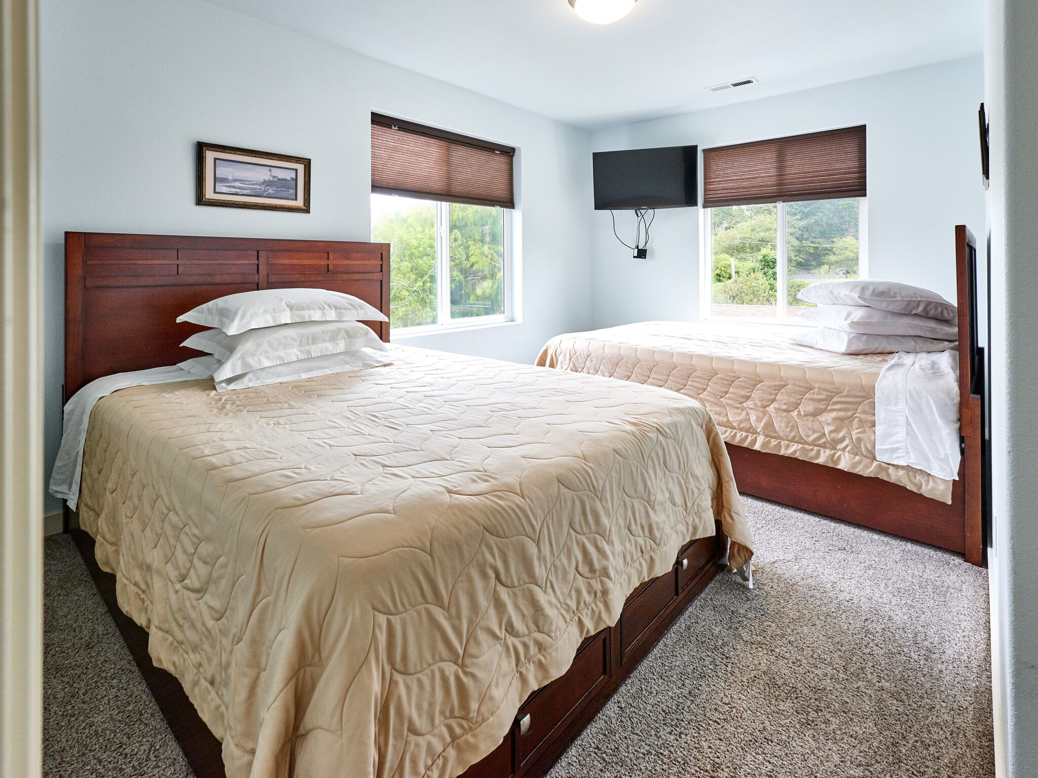 Vacation home bedroom with two beds.