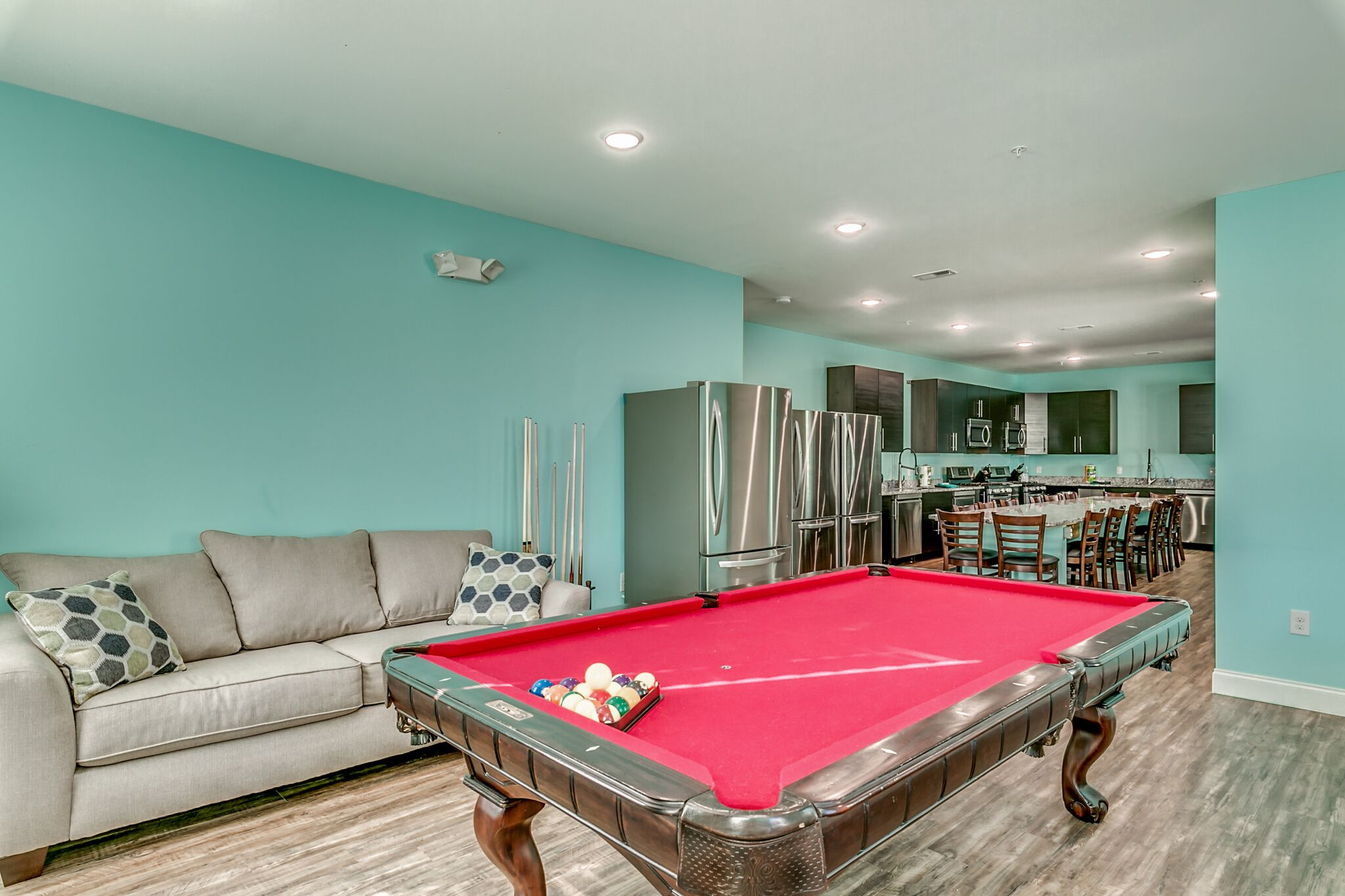208 3rd Ave kitchen, long dining table and pool table.