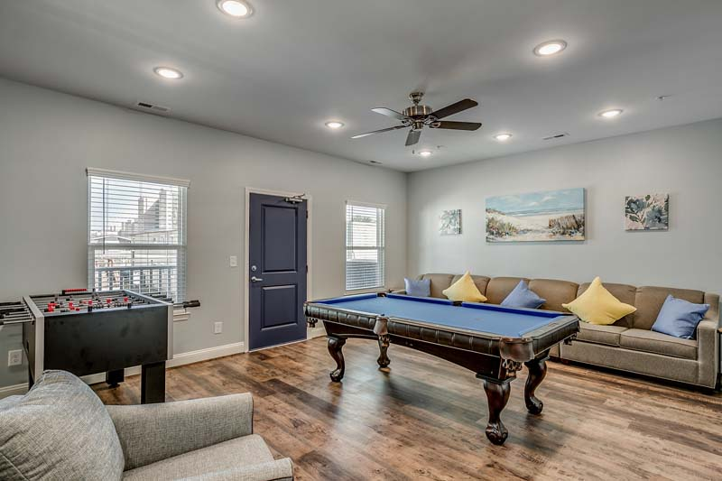 206 54th Ave N - parlor room with pool table and foosball.