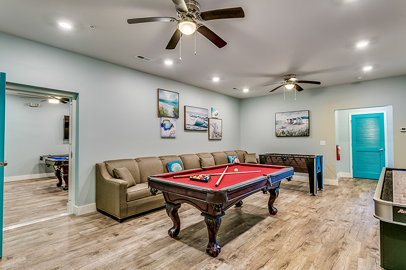 Unit A Game room with pool table.